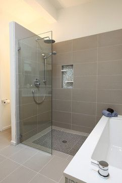 Pure white caeserstone tub surround, hansgrohe metris faucet, glass mosaic tile (Daltile - City lights), taupe 12 x 24 porcelain floor (tierra Sol, English bay collection), shower glass panel, shower niche, rain shower head, wet bath.