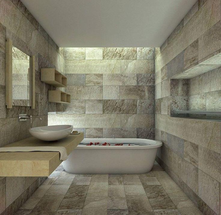 Carrelage mural et de sol en pierre naturelle dans la salle de bain contemporaine aménagée avec