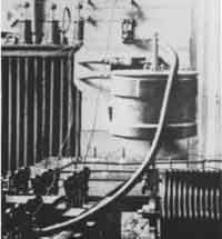 Nikola Tesla's experimental station at Colorado Springs. Interior close up, of oscillator components including condensers, regulating coil, and Westinghouse high tension transformer. December 1899.