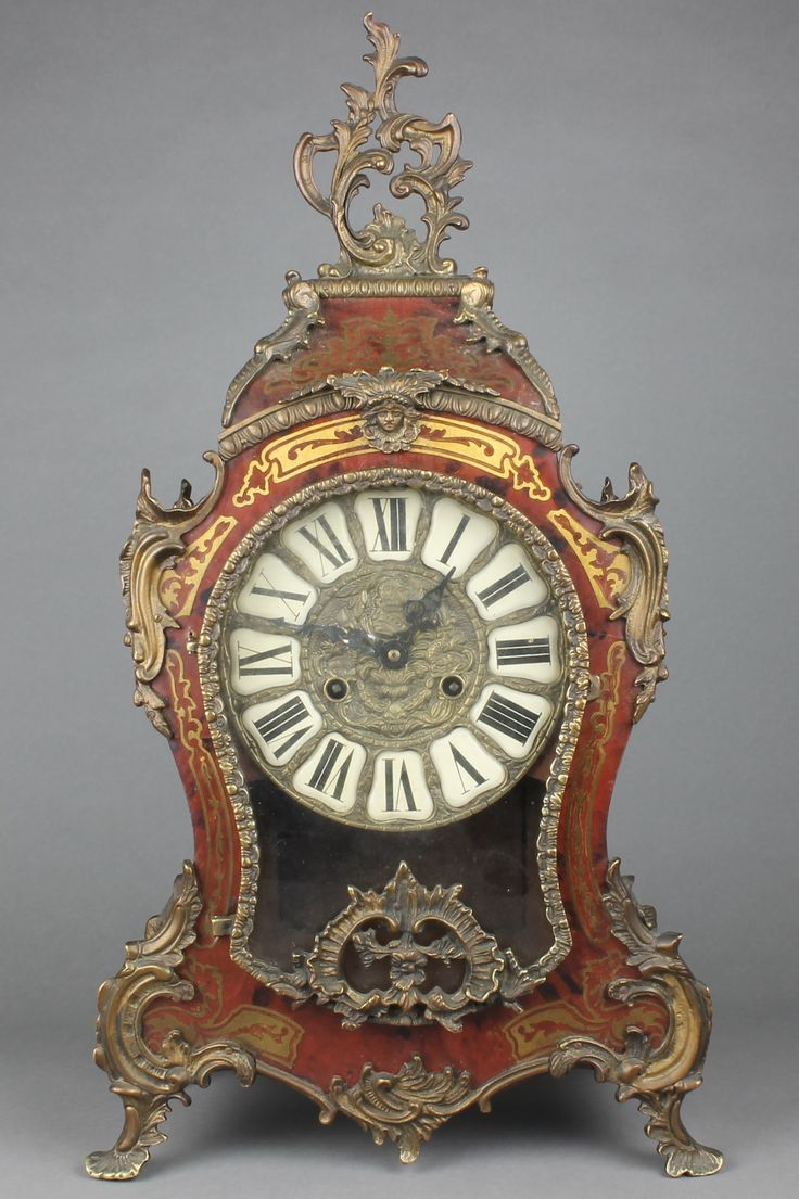 Lot 1090c, A German striking mantel clock contained in a red bulle case with Roman numerals, est  £50-75