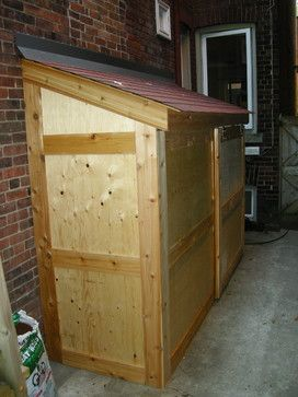 Small storage shed with sliding door
