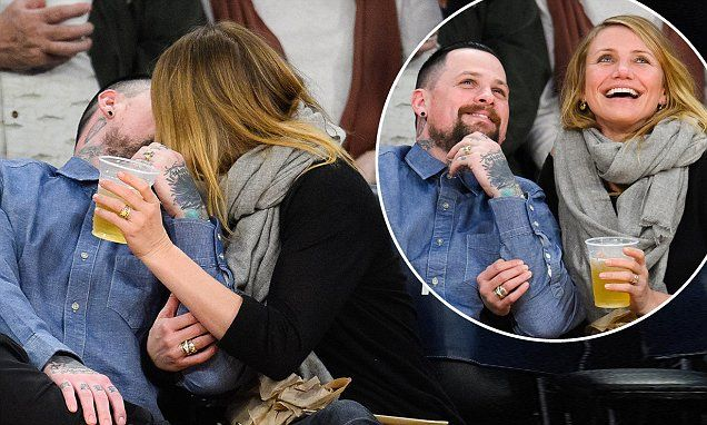 Cameron Diaz and Benji Madden share a passionate kiss at Lakers game