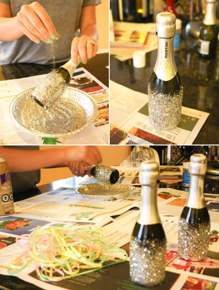 Okay this might be dumb... but what if we all saved our wine bottles starting now, removed the labels, and put glitter on the bottom? There could be like three per table as a centerpiece as vases, perhaps with silver spray painted branches in them...?