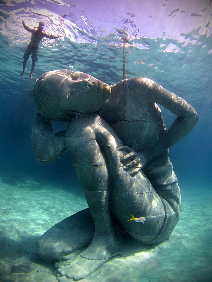 Earlier this month, artist Jason deCaires Taylor installed this stunning 18-feet-tall, 60-ton underwater sculpture of Bahamian girl carrying the weight of the ocean in Nassau, Bahamas. | An 18 Foot, 60 Ton Girl Holds Up The Ocean In The World's Largest Ever Underwater Sculpture