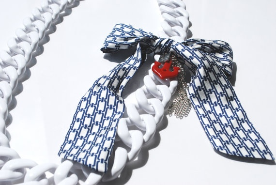 100 cm long large link chain necklace made of white resin.  Navy-like side accessory; resin anchor and metal chain tied by a large tie-like silk bow.    This object has been made with optimum quality entirely handmade materials and accessories. Each small imperfection makes the item unique. #jewels