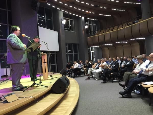 """Otniel Bunaciu, president of the European Baptist Federation and a Romanian theologian, preaches during the opening session of the EBF's 2015 council meeting in Sofia, Bulgaria. He asked worshippers to consider, """"How would refugees hear the word of God?"""" Photo by Nabil Costa."""
