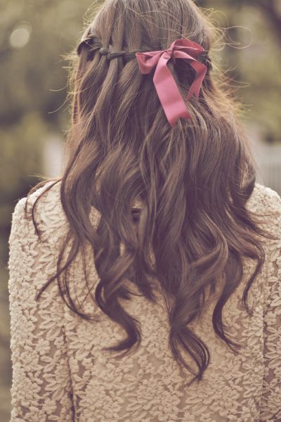 Waterfall braid and red bow