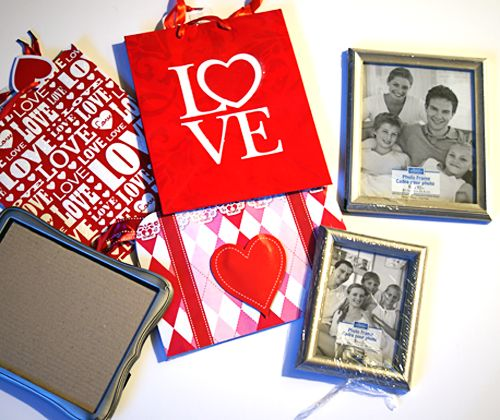 Dollar Store Valentine's Decor — Saved By Love Creations  Framed gift bags make for quick holiday decor.  http://savedbylovecreations.com/2013/01/dollar-store-valentines-decor.html