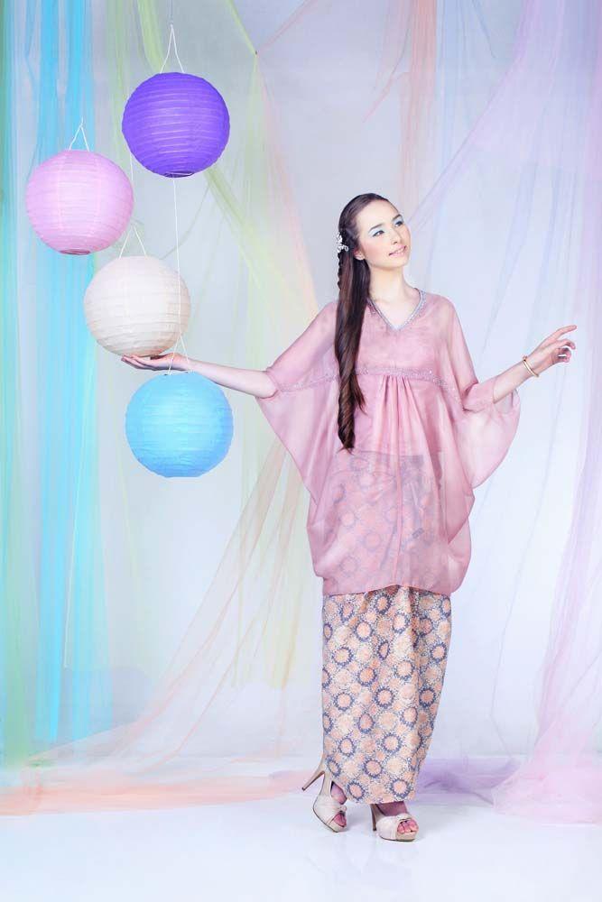 Pink chiffon top by  Maysuda.  Peach and blue batik by Batik Keris.  Golden bracelet by Chloris. Cream open-toe heels by Amante.
