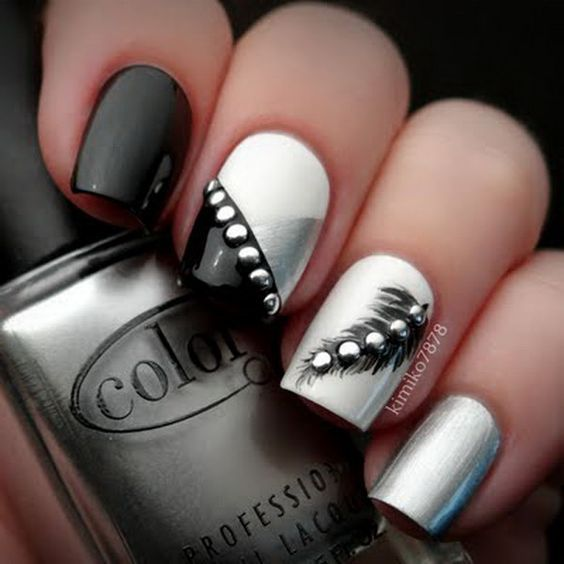 Rocker Chic Feather Nails with Silver Studs. Very pretty! I have to say, I am really into this feather design.: