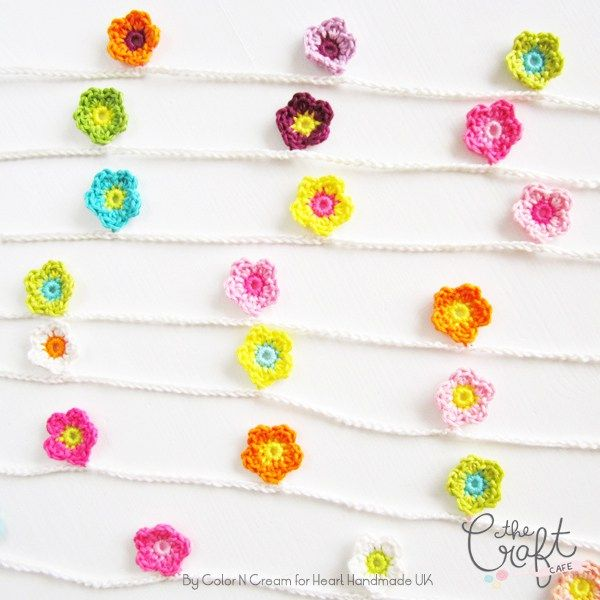 A free crochet pattern for a rather adorable flower garland! A great beginner crochet pattern available here. This garland would look so cute in a little girls room or even in your craft room.