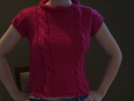 This flirty pink sweater is a Womens size small. Bust - 12.5 inches (lying flat) Length - 18.5 inches