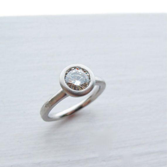 Forever Brilliant moissanite and palladium engagement ring