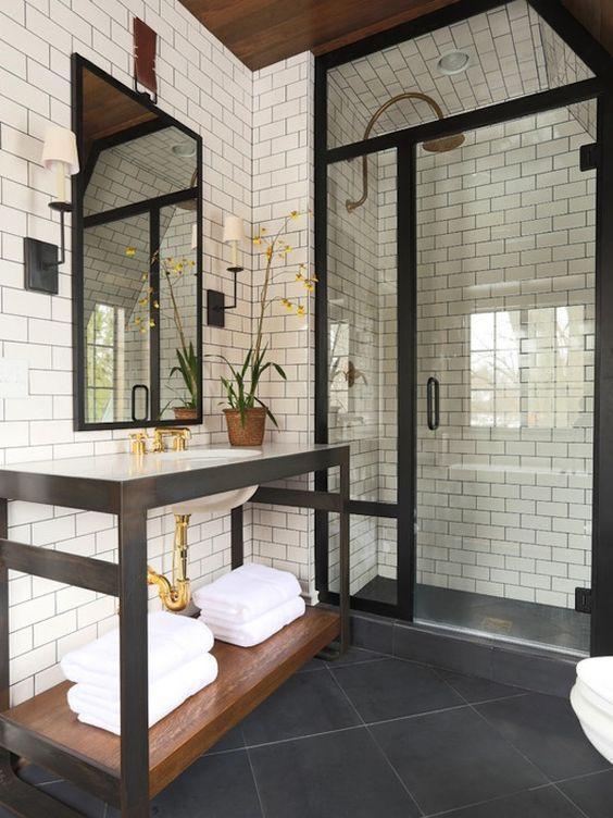 Masculine Bathroom With Steel Finishes Subtle Brass Accents And Gorgeous Walk In Shower