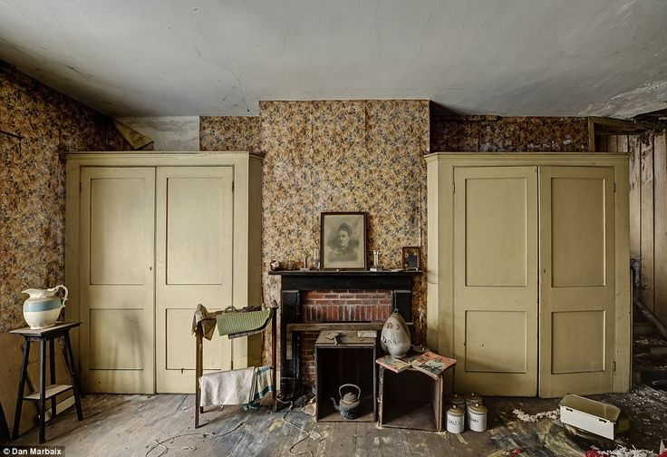 History: Wallpaper peels in this room, possibly the kitchen, which still has canisters for dry goods, an old copper kettle and a large porce...