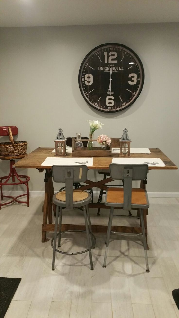 Big clock from Hobby Lobby  vintage drafting table with mismatched  industrial stools  Antique tool box with old milk bottles and flowers   Cotton placemats. Best 25  Industrial placemats ideas on Pinterest   Countryside