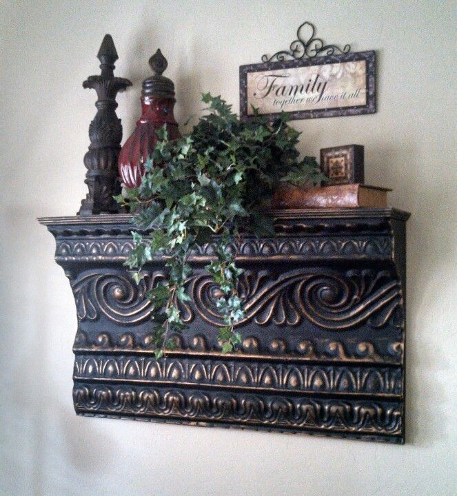 Tin shelf I made for my mother-in-law.. She has it decorated so cute! This piece is 3ft long and painted black and gold. Find me on Instagram @decorcreateur #decorcreateur