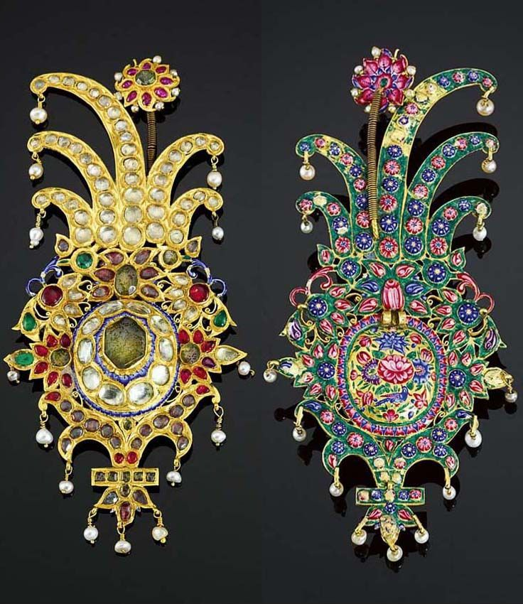 A LARGE QAJAR GEM-SET AND ENAMELLED GOLD TURBAN ORNAMENT, PERSIA, 19TH CENTURY. of ovoid form with asymmetrical cresting, the front lavishly set with diamonds, rubies, emeralds and other stones with a raised central section part-enamelled, the border of openwork foliate motifs set with gems, a fringe of pendant pearls, the cresting set with diamonds and fringed with pearls, the reverse with enamelled design including a bird amidst flowers and foliage. 18cm. height