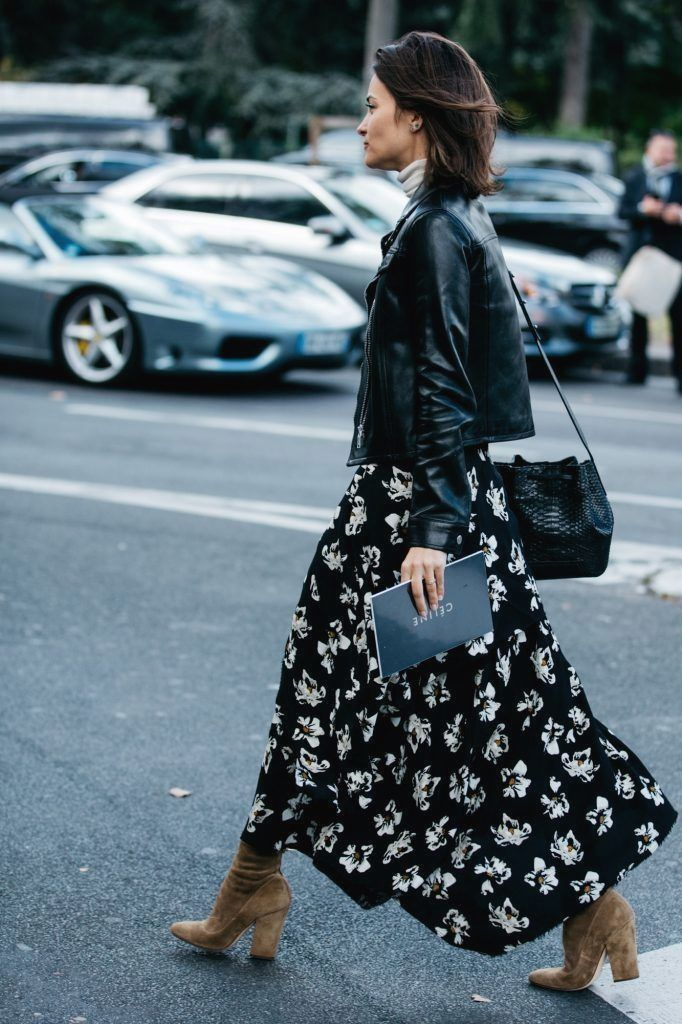 Floral black maxi dress, black leather biker jacket, black crocodile bucket bag and beige suede boots .Paris Fashion Week 2017 street style.