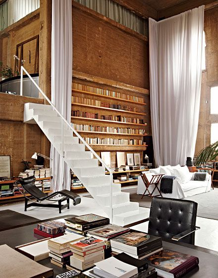 """From OtherSideReflections on Reddit: """"Home library and lounge of a former cement factory in Barcelona"""".    Click through for more awesomeness."""