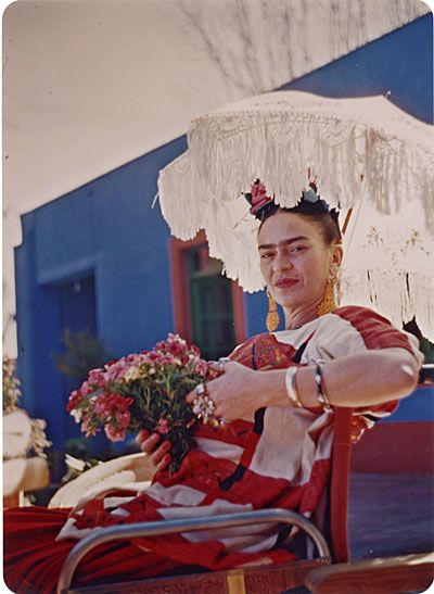 Citation: Frida Kahlo on the patio of the Blue House, 195-? / Florence Arquin, photographer. Florence Arquin papers, Archives of American Art, Smithsonian Institution.