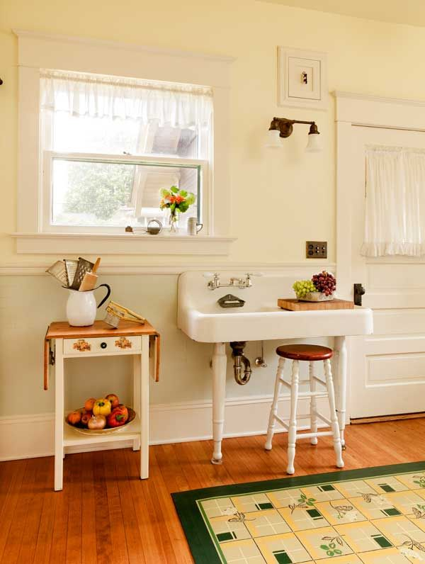 An old porcelain sink on legs, smaller than the huge one found in the kitchen, allows access to the door to the back porch.