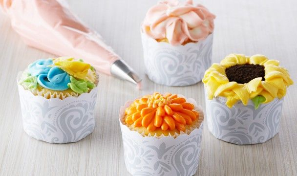 How to pipe Begonia, Pansy, Sunflower, & Gerbera Vanilla Cupcakes with Floral Frosting | The Home Channel