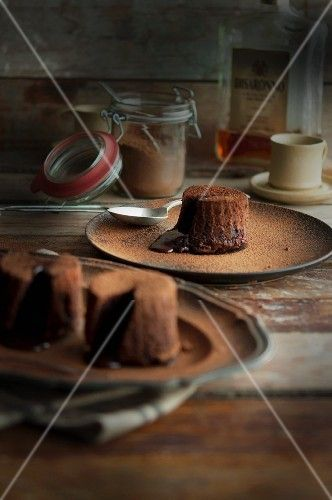 Fondant au chocolat dusted with cocoa powder