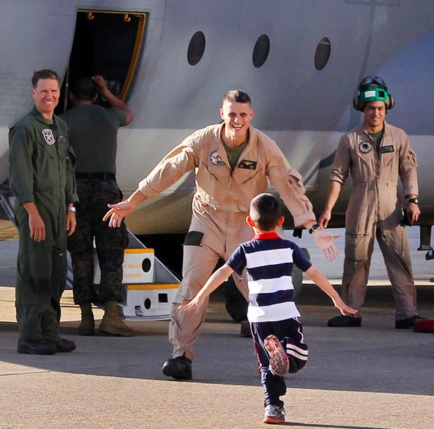 The son who just couldn't wait: | 22 Life-Affirming Photos Of Servicemen And Women Coming Home From Deployment