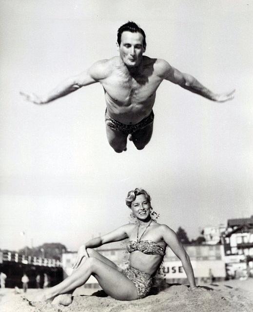 1959 50s 60s found photo print ad beach bikini flying man gymnastics gymnist