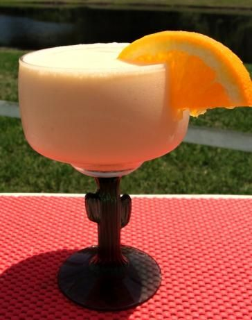 Adult Orange Dreamsicle    1 cup orange juice   4 ounces orange liqueur   4 ounces ice cream (vanilla)   4 ounces orange sherbet   4 tablespoons non-dairy coffee creamer (French vanilla)   1 teaspoon vanilla extract   1/2 cup ice (crushed)     In Blender, add everything, blend till smooth. DRINK.