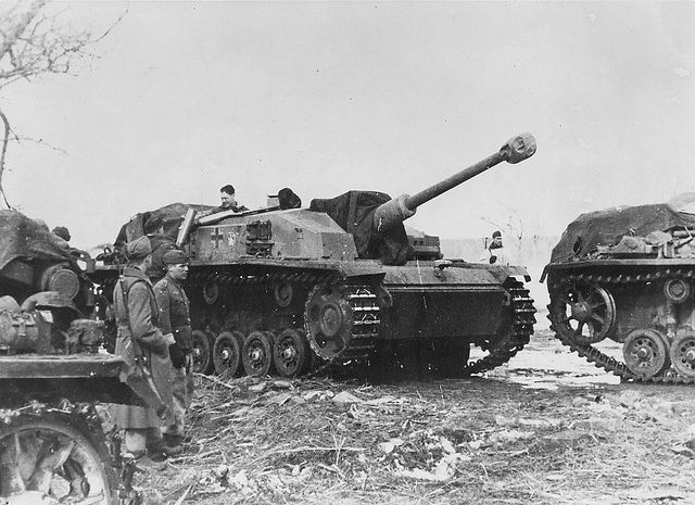 German Tank destroyer Sturmgeschütz III (StuG.III). Assault guns are replenishing ammunition during battles on the Mius River. The Mius-Front was a heavily fortified defensive line created by the Germans in October 1941 under direction of General Paul Ludwig Ewald von Kleist along the Mius River during World War II. Soviet troops twice tried to break through this line. The soviets finally succeeded in August 1943 when troops of the Southern Front broke through the German lines.