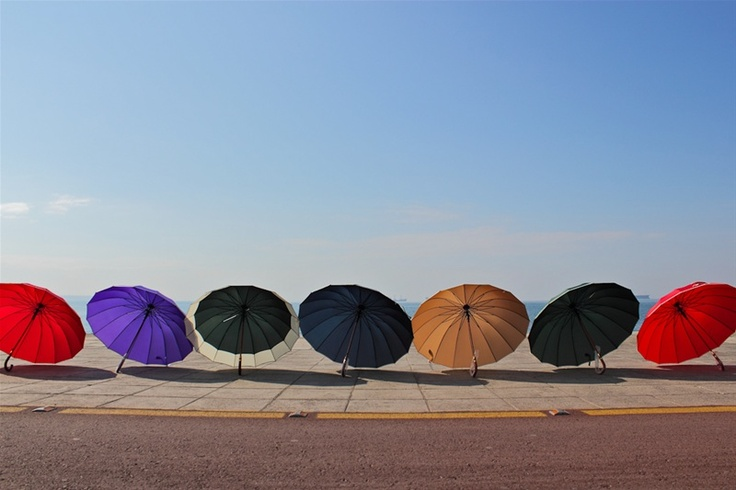 This photo is taken at Thessaloniki bay/waterfront and the umbrellas are put this way in order to be sold (illegally), actually they are merchandise!