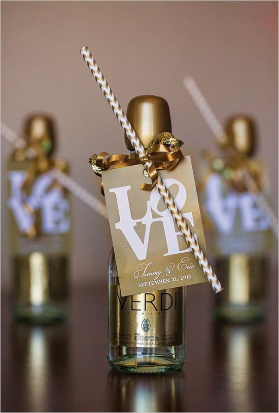 Mini champagne bottles with sipping straws and cute love labels
