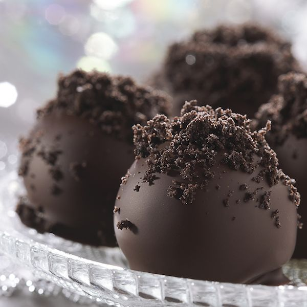 OREO Cookie Balls  1 pkg.  (8 oz.) PHILADELPHIA Cream Cheese, softened 36  OREO Cookies, finely crushed (about 3 cups) 4 pkg.  (4 oz. each) BAKER'S Semi-Sweet Chocolate, broken into pieces, melted  MIX cream cheese and cookie crumbs until blended.  SHAPE into 48 (1-inch) balls. Freeze 10 min. Dip balls in melted chocolate; place in single layer in shallow waxed paper-lined pan.  REFRIGERATE 1 hour or until firm.