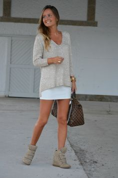 dress down a skirt and sweater with wedge sneakers
