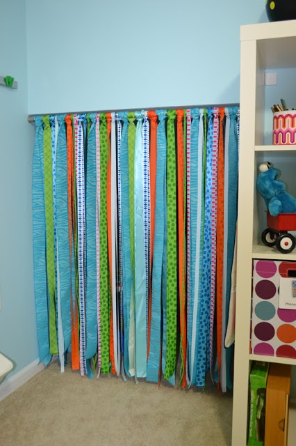 Thinking about taking the door down for the booknook and doing this instead-or maybe using strips of fabric -Fun Ribbon Curtains for playroom