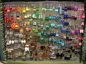 While I was studying abroad last semester I got a brilliant idea for a  jewelry carrying case. I decided to get an old suitcase from the thr...