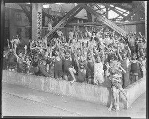 Children posing in the free wading pool beneath the Municipal Free Bridge, South Fourth Street and Chouteau Avenue. Photograph taken by Isaac Sievers for Sievers Studio in 1931. Sievers Studio Collection, Missouri History Museum.