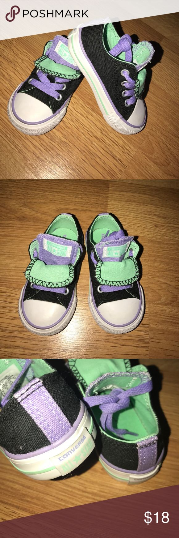 All Star Converse Toddler Size 5 These converse sneakers are in great condition, practically new. They have a unique double layered tongue. Colors are Black, Purple, Mint, and White. Converse Shoes Sneakers