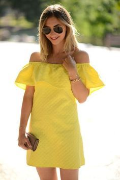 Yellow off the shoulder dress.