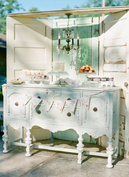 corner buffet table with freestanding backdrop & chandelier - great for an outside party.