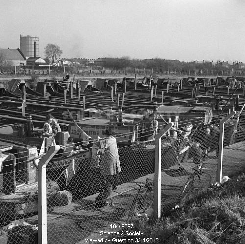 Canal barges at Bulls Bridge lay by, Southall, London, 1950.    Still photograph taken during the making of the British Transport Films production, 'Inland Waterways', showing a view of canal barges in the lay by at Southall, Greater London.