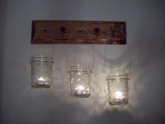 old door nob screwed into the hall way wall,mason jars with candles hanging from them. Or on back porch