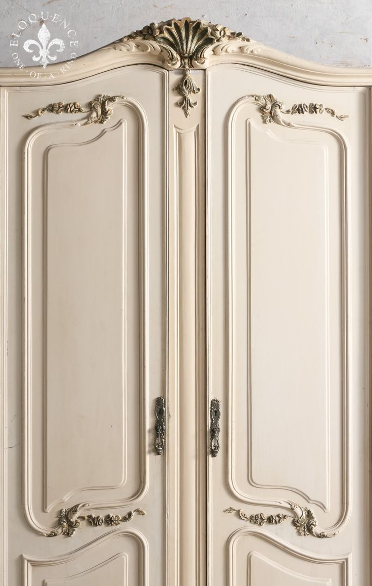 Large scale, beautiful vintage rococo style armoire in a lovely aged white with touches of gilt paint on the delicately carved details. The interior is stained wood. Grand and lovely! 90H x 121W x 26D Return Policy: This item is not eligible for returns or exchanges so please make sure to look over the pictures and ask questions before purchasing this beautiful piece.