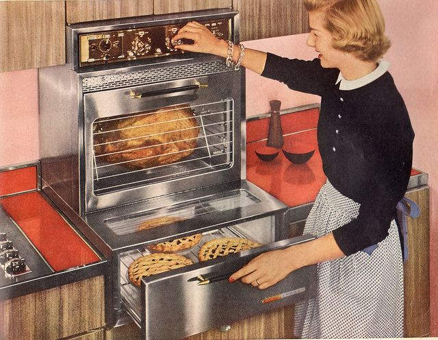 She's cooking up a tasty storem in her 1959 Philco Citation split level double oven.