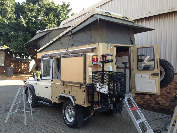 Land Rover with Abba Camper Land Rover Defender Great idea on the split roof.