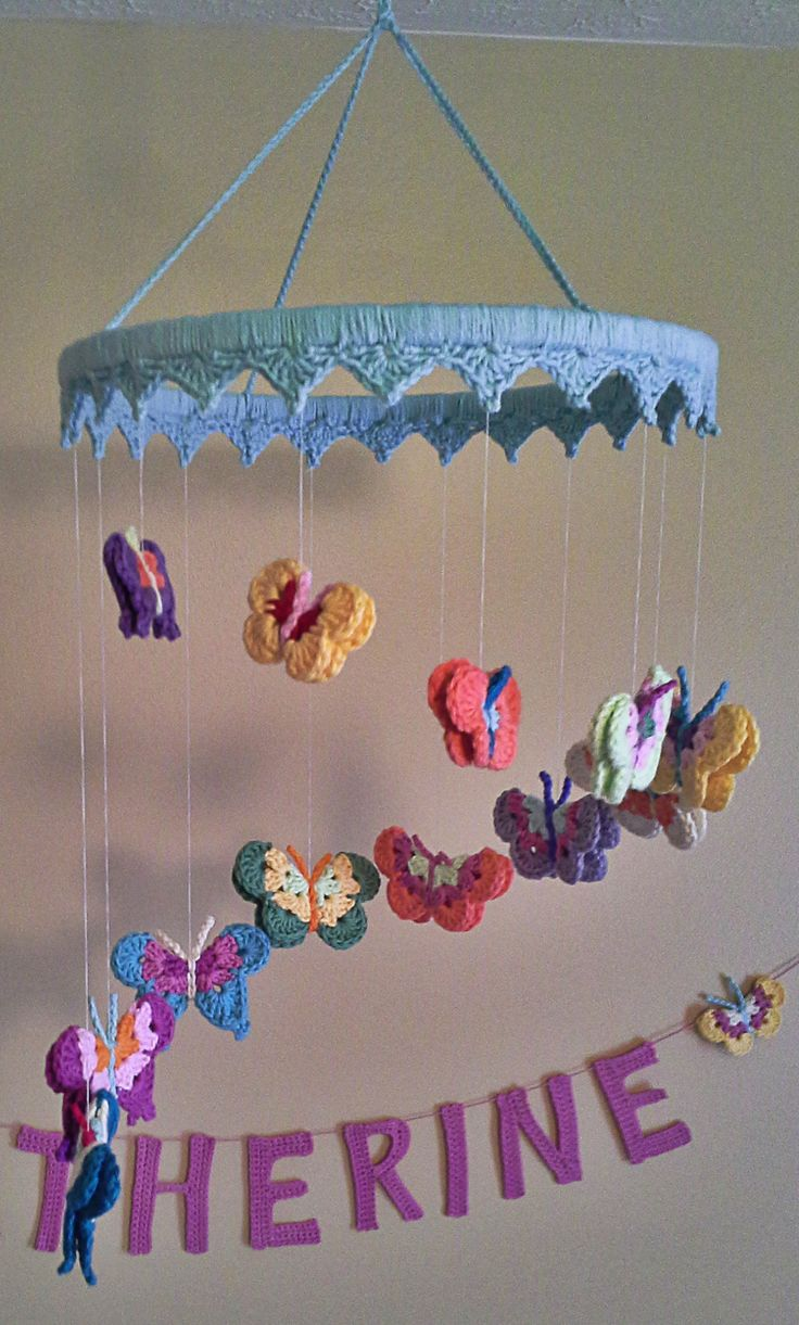 Crochet butterfly nursery mobile tutorial -- with links to free patterns.
