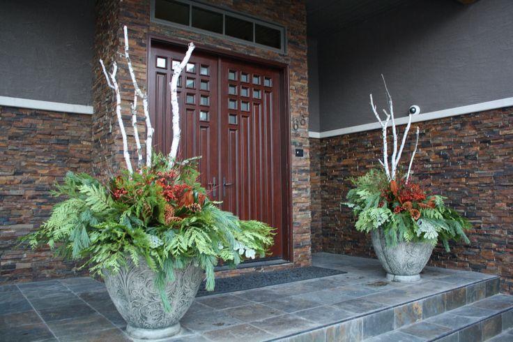 Front Door Arrangements, with fresh greenery, berries, magnolia, and birch! Designed by Sharlene Nielsen www.frontdoorstories.com