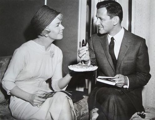 """Doris and Tony Randall eating candy in her dressing room during the making of """"Pillow Talk""""."""
